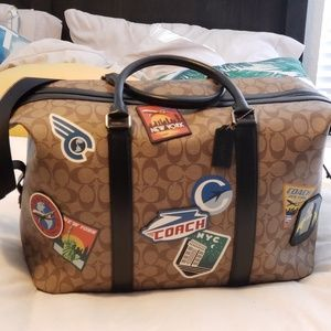 Coach Voyager signature luggage bag
